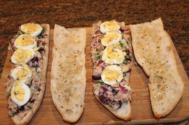 Top Kel's Tuna Bagnat with boiled egg slices