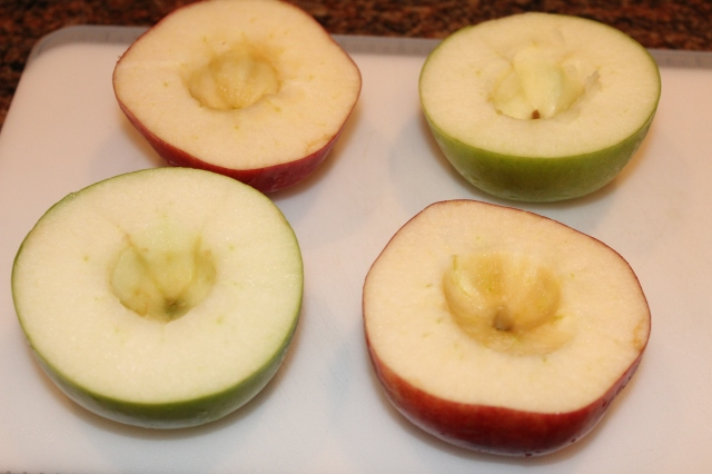 Slice apples in half and core