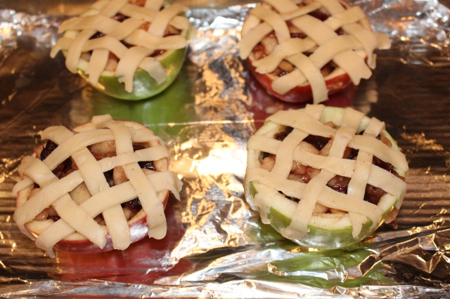 Top apples with dough strips