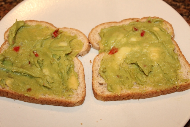 spread toast with guacamole