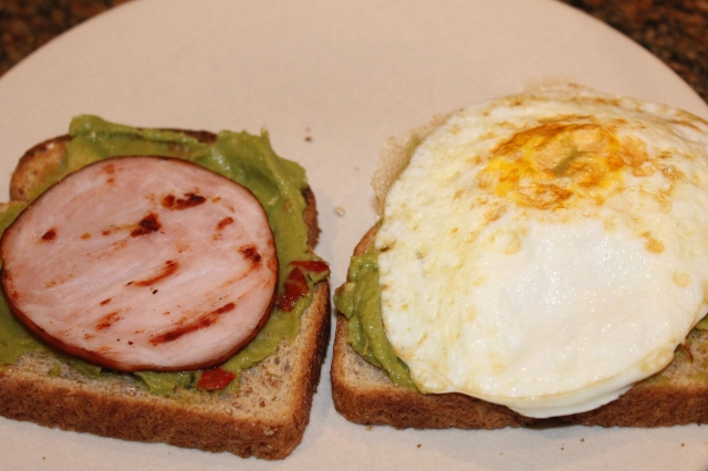 top avocado toast with canadian bacon and egg
