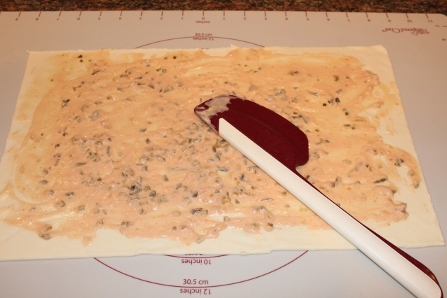 Spread 1000 island dressing over pastry