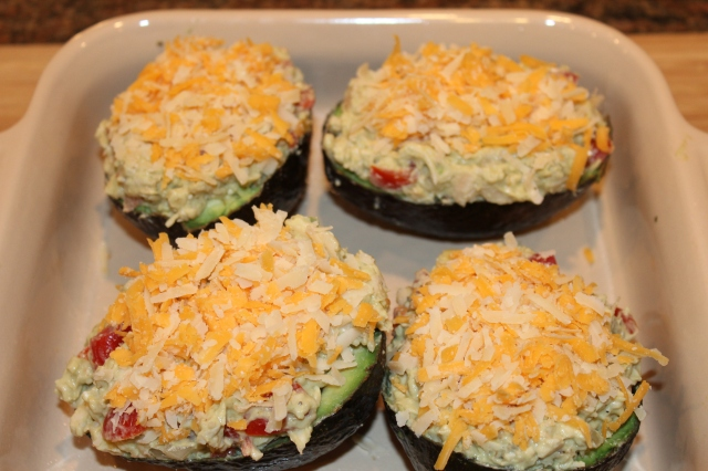 Top Kel's chicken stuffed avocados with cheese